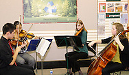 Centerville High School Orchestra members (from left) Justin Lun, Run Wei Wang, Caroline Danzi and Margaret Otto perform holiday music at the WashingtonCenterville Public Library in Centerville, Monday, December 5, 2011.