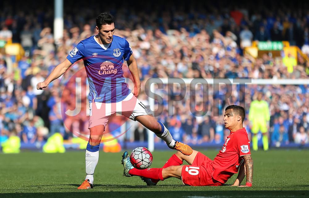 Philippe Coutinho of Liverpool tackles Everton's Gareth Barry  - Mandatory byline: Matt McNulty/JMP - 07966 386802 - 04/10/2015 - FOOTBALL - Goodison Park - Liverpool, England - Everton  v Liverpool - Barclays Premier League
