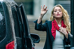 © Licensed to London News Pictures. 27/07/2020. London, UK. American actress AMBER HEARD arrives at the High Court in London, where Johnny Depp is in a legal dispute with UK tabloid newspaper The Sun over allegations he assaulted his former wife, Amber Heard. Photo credit: Vudi Xhymshiti/LNP