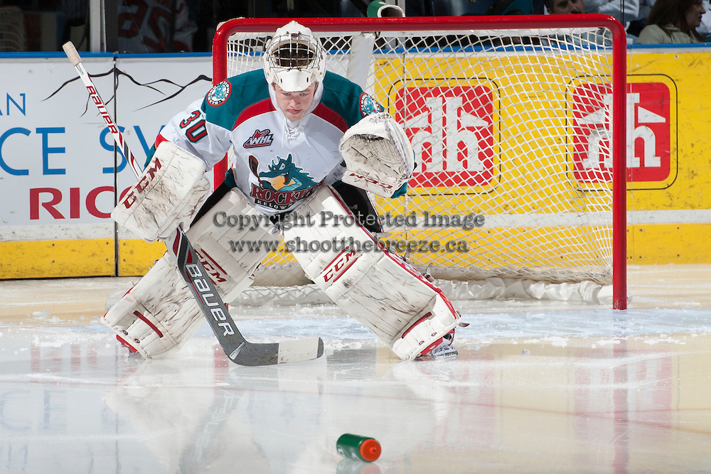 KELOWNA, CANADA - MARCH 23: Jordon Cooke #30 of the Kelowna Rockets watches his water bottle at the start of the second period against the Tri-City Americanson March 23, 2014 at Prospera Place in Kelowna, British Columbia, Canada.   (Photo by Marissa Baecker/Shoot the Breeze)  *** Local Caption *** Jordon Cooke;