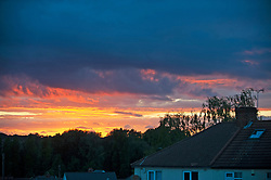 ©Licensed to London News Pictures19/06/2020<br /> Orpington, UK. A dramatic sunset mixed with dark rain clouds over South East London this evening. Photo credit: Grant Falvey/LNP