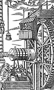 Reversible hoist for raising leather buckets from mine shaft powered by overshot waterwheel. Man in hut at O opens and shuts water races to stop and start double row of buckets. From Agricola 'De re metallica' Basle 1556. Woodcut.
