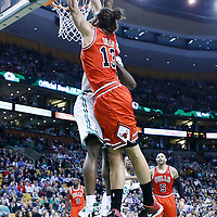 13 February 2013: Chicago Bulls center Joakim Noah (13) dunks the ball over Boston Celtics power forward Brandon Bass (30) during the Boston Celtics 71-69 victory over the Chicago Bulls at the TD Garden, Boston, Massachusetts, USA.
