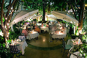 The garden-like setting of the Wish restaurant on the patio of The Hotel (formerly known The Tiffany Hotel) in Miami's South Beach.