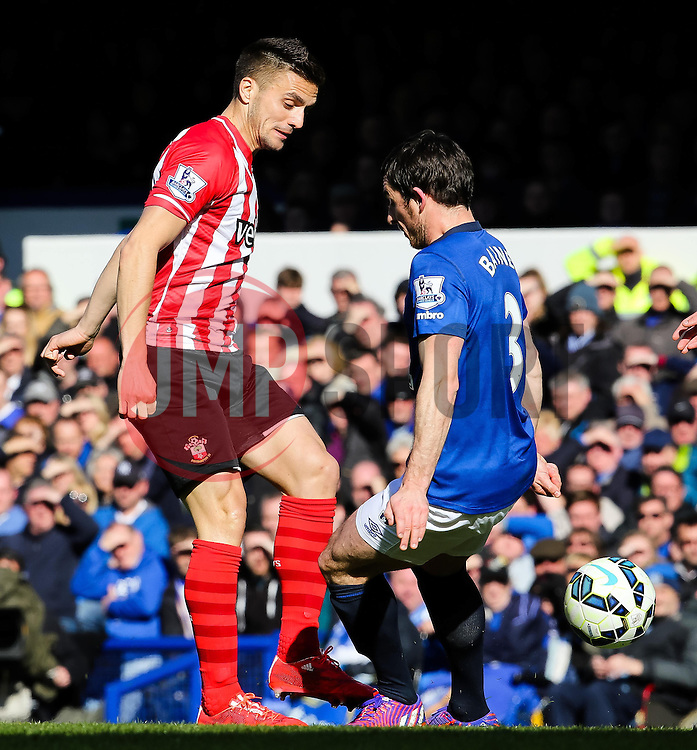 Southampton's Dusan Tadic and Everton's Leighton Baines  - Photo mandatory by-line: Matt McNulty/JMP - Mobile: 07966 386802 - 04/04/2015 - SPORT - Football - Liverpool - Goodison Park - Everton v Southampton - Barclays Premier League