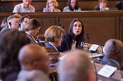 © Licensed to London News Pictures. 22/10/2018. Bristol, UK. Global Parliament of Mayors Annual Summit, 21-23 October 2018, at Bristol City Hall. Picture of LAURA HEALY from UNICEF, taking part in the plenary session on harnessing the power of migration. The Global Parliament of Mayors 2018 is the biggest and most ambitious Annual Summit to date. GPM Bristol 2018 will host up to 100 global mayors for an action-focused summit that addresses some of the biggest challenges facing today's world cities. GPM Bristol 2018's theme, Empowering Cities as Drivers of Change, will focus minds on global governance and the urgent need for the influence, expertise and leadership of cities to be felt as international policy is shaped. GPM Bristol 2018 will provide mayoral delegates with a global network of connections and a space to develop the collective city voice necessary to drive positive change. The programme will engage participants in decision-making, with panels, debate and voting on priority issues including migration and inclusion, urban security and health, and is a unique chance to influence decisions on the most pressing issues of our time. Photo credit: Simon Chapman/LNP
