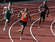 Marlboro's Zack Warden, center, takes the lead in the 200-meter dash during the Section 9 track and field state qualifier in Middletown on Friday, May 31, 2013. Warden won the race and qualified for the state meet in the 100-meter dash,  200 meter-dash and 400-meter relay.
