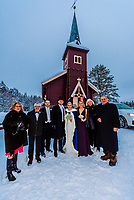 The bridal party and the parents  after their wedding ceremony at Plassen Church, a wooden (stave) church originally built in 1879. It burnt to the ground in 1904 and was rebuilt in 1907. Trysil, Norway.
