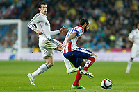 Real Madrid´s Gareth Bale (L) and Atletico de Madrid´s Juanfran during Spanish King´s Cup match at Santiago Bernabeu stadium in Madrid, Spain. January 15, 2015. (ALTERPHOTOS/Victor Blanco)