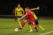 York City midfielder Josh Carson goes past Oxford United defender, on loan from MK Dons, George Baldock  during the Sky Bet League 2 match between York City and Oxford United at Bootham Crescent, York, England on 29 September 2015. Photo by Simon Davies.