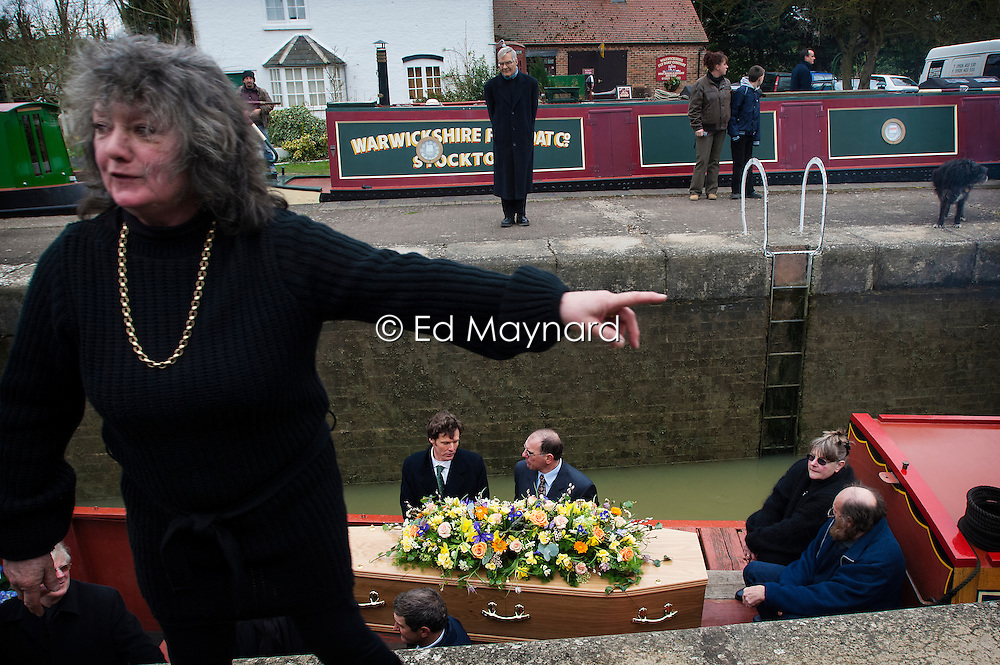 Madeleine Forth at the funeral procession for her husband and boatman John Forth as it passes through the locks on the Grand Union Canal in Long Itchington, near Southam, Warwickshire, England, UK.