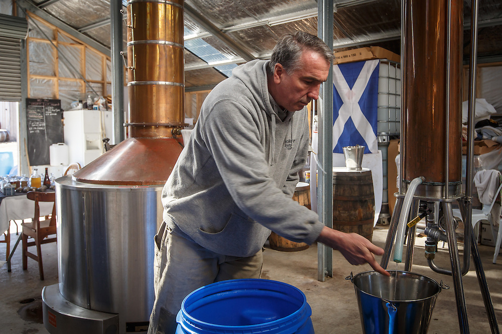 McHenry Distillery owner Bill McHenry checks to make a heads cut during a distillation run at McHenry Distillery in Port Arthur, Tasmania, August 25, 2015. Gary He/DRAMBOX MEDIA LIBRARY
