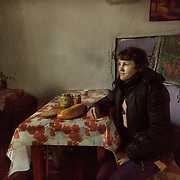 Tatiana Ignatiuk in her kitchen in Maksimovichy, where she lives with her three children and husband who works in the forest