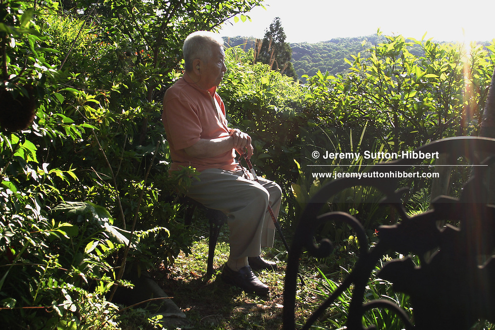 Tsutomu Yamaguchi in his garden, on Wednesday May 25th 2005. Yamaguchi was in Hiroshima on the day of the first atomic bombing, 6th Aug. 1945, and also in Nagasaki three days later on the day of the second atomic bombing of Japan by US Military.