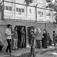 Egypt / Syrian refugees / Dozens of Syrian refugees outside of the UNHCR offices wait to register for protection and other social services in the Zamalek neighborhood in Cairo, Egypt, Tuesday, May 28, 2013. Many Syrian refugees fled the violence in their homeland and were displaced to neighboring countries, including Egypt. The Ministry of Foreign Affairs estimates that there may be almost 150,000 Syrian refugees in Egypt, most of whom reside in the cities of Cairo and Alexandria.  / UNHCR / Shawn Baldwin / May 2013
