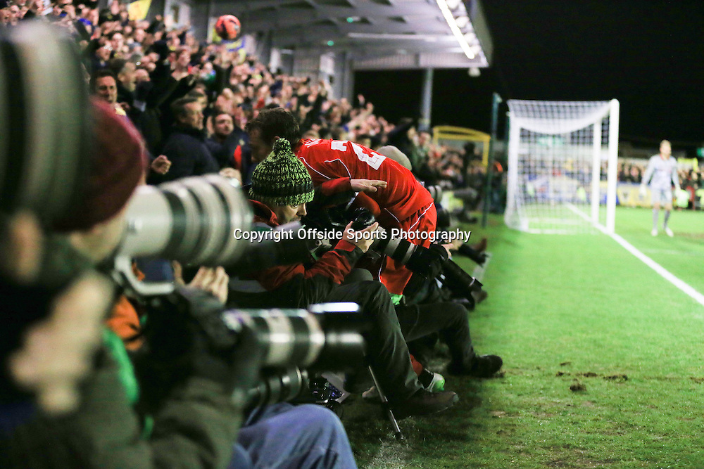 5 January 2015 - The FA Cup 3rd Round - AFC Wimbledon v Liverpool - Lucas Leiva of Liverpool collides with photographers - Photo: Marc Atkins / Offside.