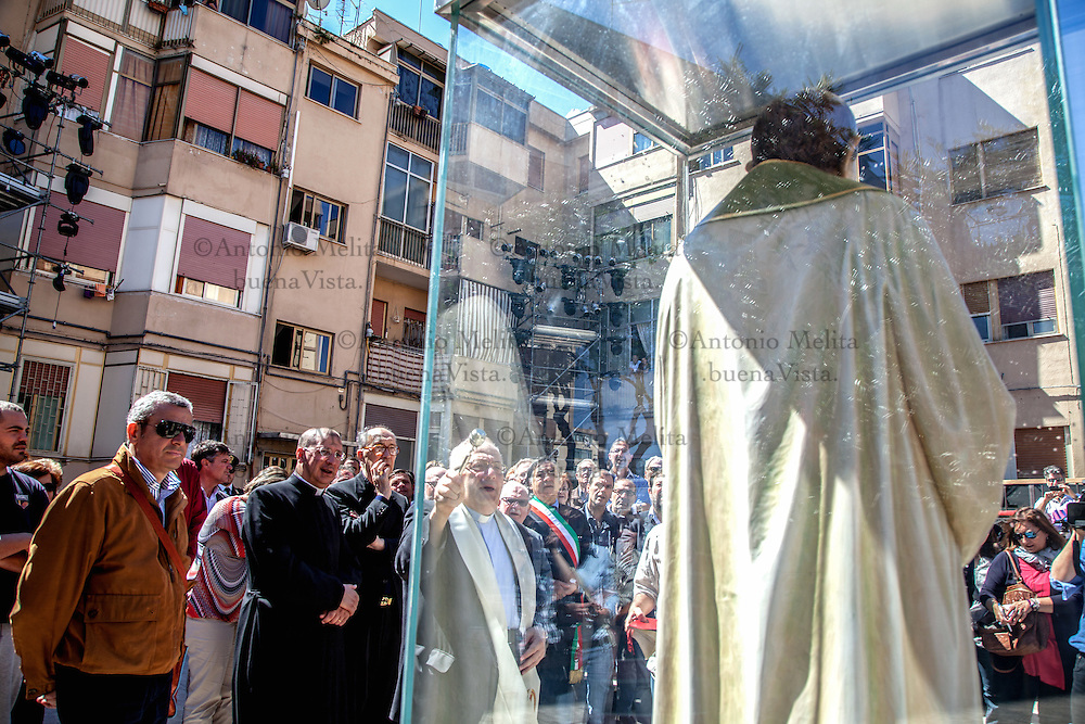 After the ceremony of beatification of Father Pino Puglisi, a wooden statue, inside a glass case, was placed where he was killed. After the ceremony of beatification of Father Pino Puglisi, a wooden statue, inside a glass case, was displayed where the anti-mafia's priest was killed on September 15, 1993.