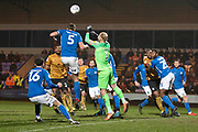 Macclesfield Town defender Fiacre Kelleher head the ball  during the EFL Sky Bet League 2 match between Macclesfield Town and Crewe Alexandra at Moss Rose, Macclesfield, United Kingdom on 21 January 2020.