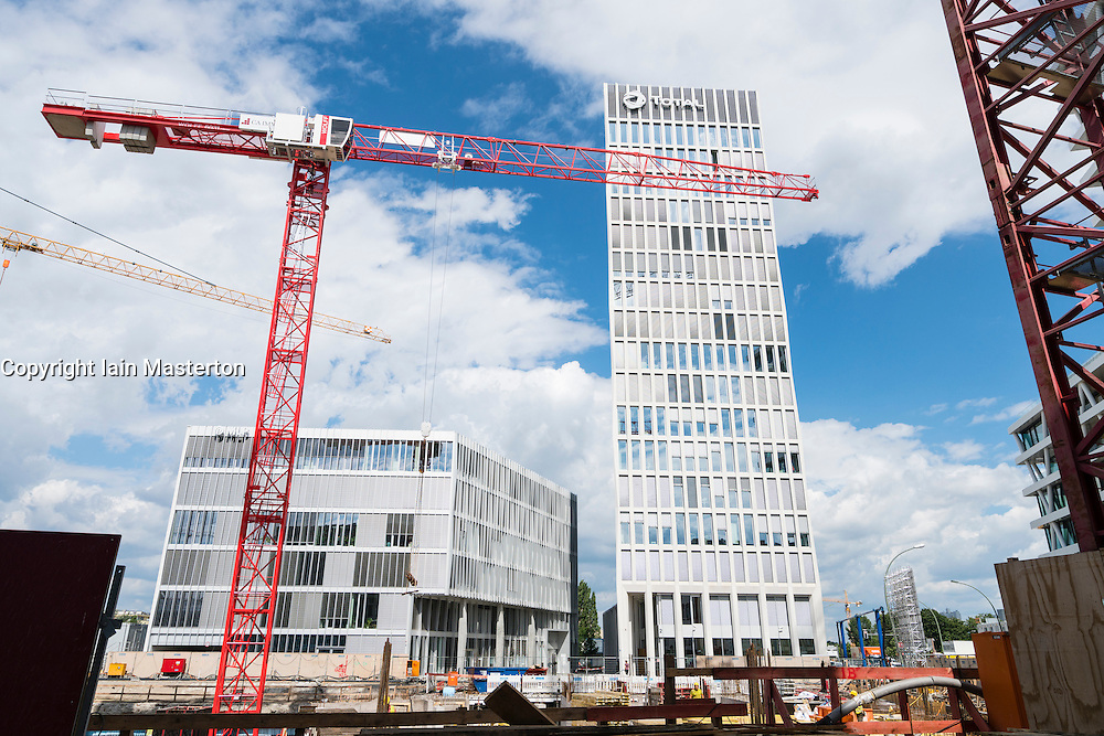 View of new office towers under construction and Total company tower in new Europacity property development in Berlin Germany