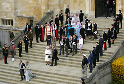 Prince Charles and Camilla Parker Bowles, followed by family and friends, leave the Service of Prayer and Dedication following their marriage at The Guildhall in Windsor.<br />