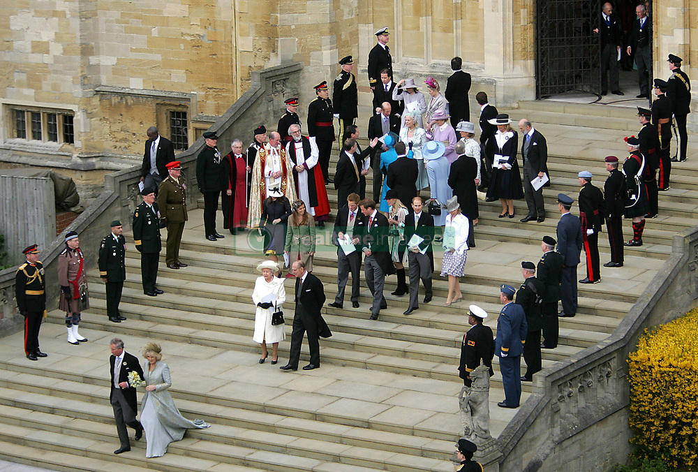 Prince Charles and Camilla Parker Bowles, followed by family and friends, leave the Service of Prayer and Dedication following their marriage at The Guildhall in Windsor.<br />Anwar Hussein/allactiondigital.com