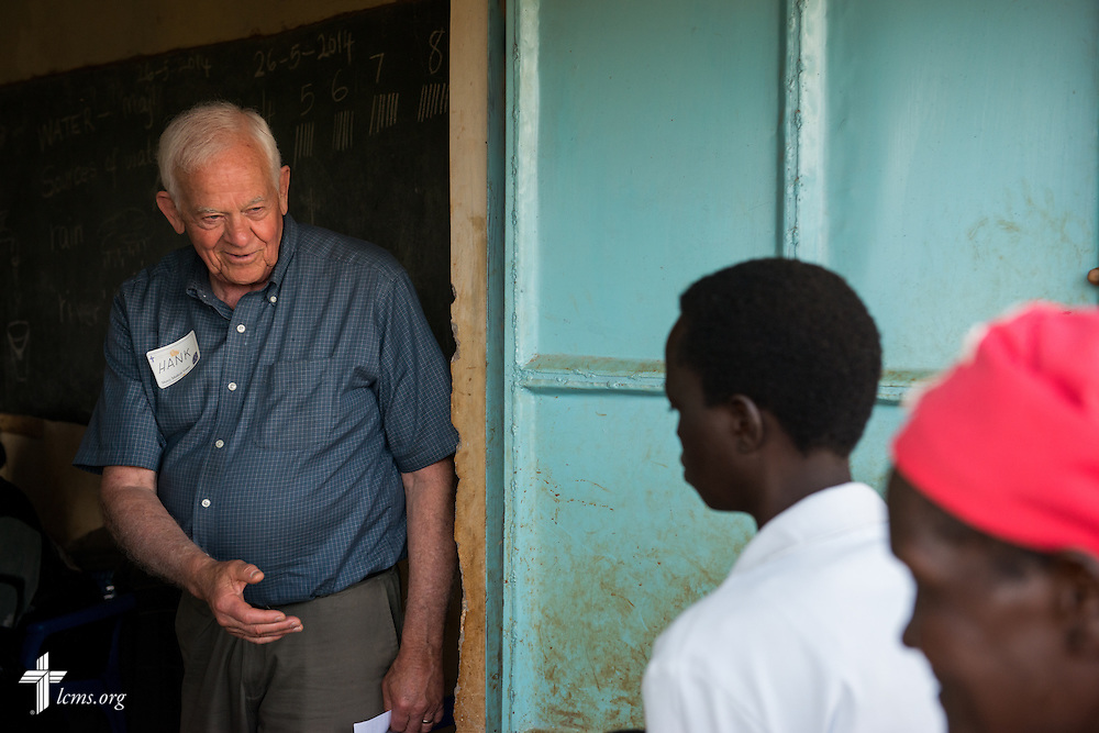 "Henry ""Hank"" Betts of Rockport, Mass., directs patients during the Mercy Medical Team clinic Friday, June 13, 2014, at the Luanda Doho Primary School in Kakmega County, Kenya. LCMS Communications/Erik M. Lunsford"