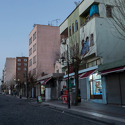 A street in the Sur district of Diyarbakir, near the destroyed parts of the Savas neighborhood. With exception of the business on the first floor, these buildings are vacant. Photographed on March 21, 2017.