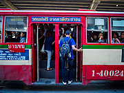 25 SEPTEMBER 2017 - RANGSIT, PATHUM THANI, THAILAND:  Commuters going into Bangkok board a bus at a Rangsit bus stop.      PHOTO BY JACK KURTZ