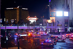 Oct 1, 2017 - Las Vegas, Nevada, U.S. - Las Vegas Metro Police and medical workers stage in the intersection of Tropicana Avenue and Las Vegas Boulevard South after a mass shooting at a music festival on the Las Vegas Strip Sunday, Oct. 1, 2017. At least 58 people died in the shooting and 515 people were injured Sunday night. The shooting has become the deadliest in modern U.S. history. The suspect, 64-year-old Stephen Paddock, was found dead in his Mandalay Bay hotel room. (Credit Image: © Steve Marcus/Las Vegas Sun via ZUMA Wire)