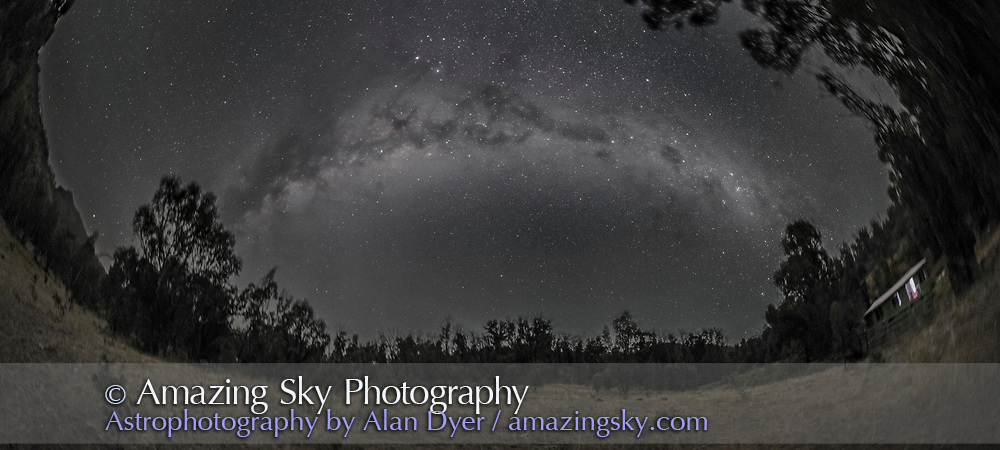 A 270&deg; nightscape panorama of the Milky Way from Carina (at right) to Scutum (at left) arching over the paddock next to the Tibuc Gardens Cottage near Coonabarabran, NSW, Australia, on April 12, 2016. The Dark Emu is visible in its entirety, from the head in Crux at right to his feet in Scutum at left. Scorpius with Mars and Saturn are at top left. Some green airglow tints the horizon. The ground is illuminated only by starlight.<br /> <br /> This is a stitch of 6 panels, each 2.5-minute exposures, all tracked on the iOptron Sky Tracker, with the 15mm full-frame fish eye lens (in portrait orientation) at f/2.8 and filter-modified Canon 5D MkII at ISO 3200. The sky is not trailed but the tracking has blurred the ground slightly. Stitched in PTGui software with fish-eye projection. This version of the image has been processed to make the view better resemble what you see with the unaided eye, in a largely monochrome and softer view than the colourful and high-contrast views commonly presented in astrophotos. Even at that there is more fine structure present in the Milky Way than the unaided eye usually sees, though binoculars beging to reveal that smaller detail. I have left some colours in some stars and in the foreground of landscape scenes.