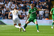 Preston North End forward Tom Barkhuizen (29) and Leeds United midfielder Kalvin Phillips (23)  during the EFL Sky Bet Championship match between Leeds United and Preston North End at Elland Road, Leeds, England on 12 August 2017. Photo by Ian Lyall.