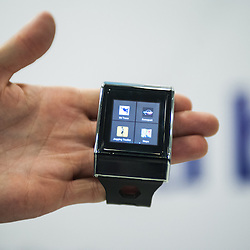 London, UK - 17 March 2014: apps menu on the XS-3 Android Smart watch-phone by Exetech at the Wearable Technology Conference at Olympia in London