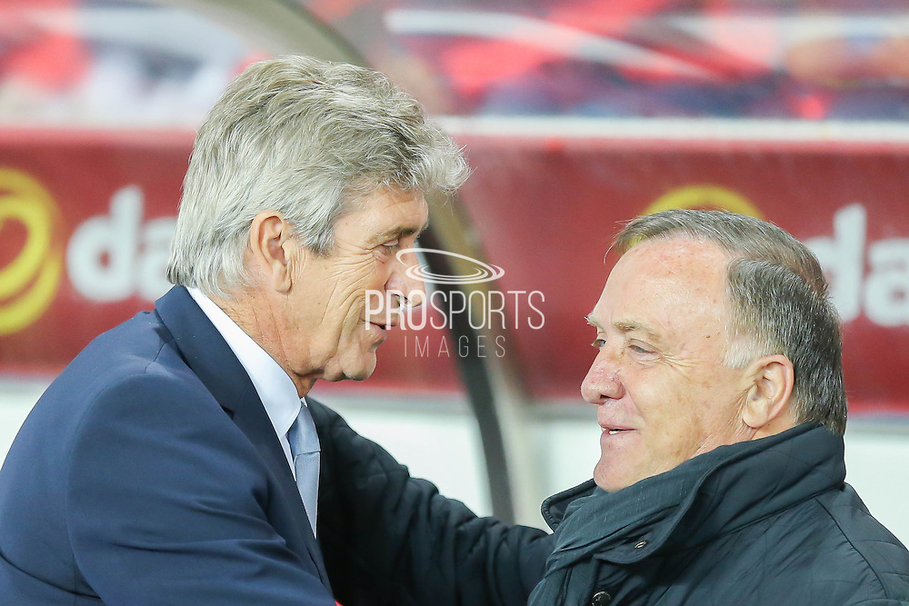 Pellegrini and Sunderland Manager Dick Advocaat during the Capital One Cup match between Sunderland and Manchester City at the Stadium Of Light, Sunderland, England on 22 September 2015. Photo by Simon Davies.