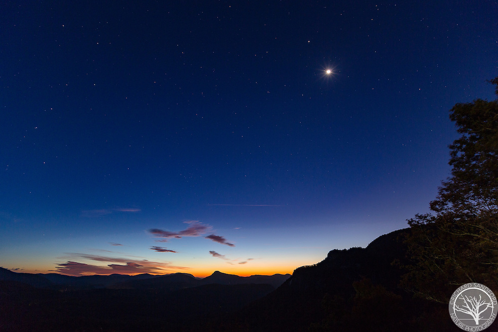The crescent Moon, the planet Jupiter and the Big Dipper show nicely just prior to dawn twilight. Rhodes Big View Overlook, near Cashiers, North Carolina