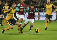 Football - 2016 / 2017 Premier League - West Ham United vs. Arsenal <br /> <br /> Manuel Lanzini of West Ham tries to find a way through the Arsenal defence at The London Stadium.<br /> <br /> COLORSPORT/DANIEL BEARHAM
