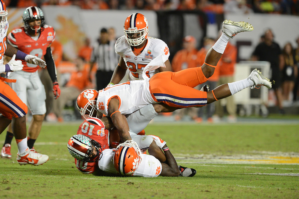 January 3, 2014: Jayron Kearse #20 and Brashaud Breeland #17 of Clemson tackle Corey Brown #10 of Ohio State during the NCAA football game between the Clemson Tigers and the Ohio State Buckeyes at the 2014 Orange Bowl in Miami Gardens, Florida. The Buckeyes led the Tigers 22-20 at the half.