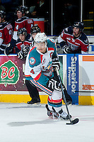 KELOWNA, CANADA -FEBRUARY 19: Madison Bowey #4 of the Kelowna Rockets skates with the puck against the Tri City Americans on February 19, 2014 at Prospera Place in Kelowna, British Columbia, Canada.   (Photo by Marissa Baecker/Getty Images)  *** Local Caption *** Madison Bowey;