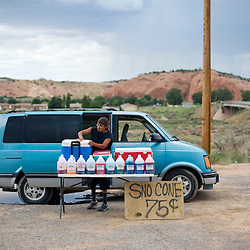 081811       Brian Leddy.Larryn Largo pours a snow cone on the corner of Highway 118 and 566 on Wednesday in Churchrock. The city is considering setting aside a portion of land in the area or Red Rock Park to allow vendors to sell their wares during events.