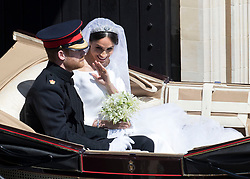 May 19, 2018 - Windsor, United Kingdom - Image licensed to i-Images Picture Agency. 19/05/2018. Windsor , United Kingdom.  Prince Harry and Meghan Markle leaving St.George's Chapel after their wedding at Windsor Castle , United Kingdom. (Credit Image: © Stephen Lock/i-Images via ZUMA Press)