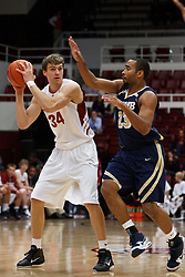 November 10, 2010; Stanford, CA, USA;  Stanford Cardinal forward Andrew Zimmermann (34) is defended by Cal State Monterey Bay Otters forward Warren Freeman (23) during the first half at Maples Pavilion.  The Cardinal defeated the Otters 87-56.