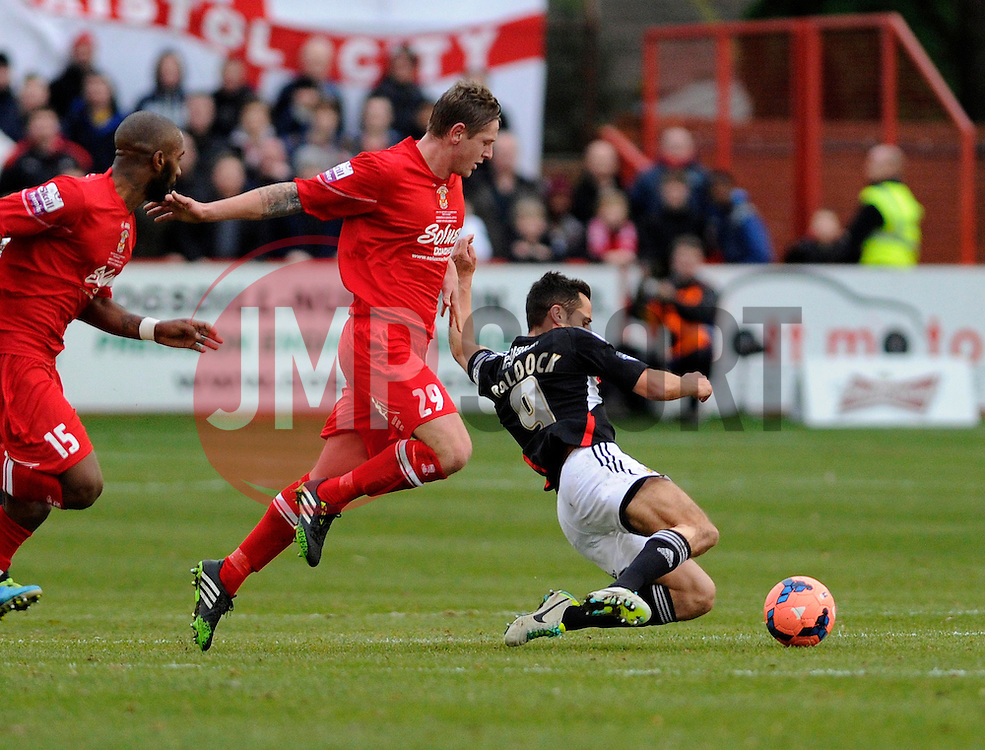 Tamworth's Lee Hildreth fouls Bristol City's Sam Baldock - Photo mandatory by-line: Dougie Allward/JMP - Tel: Mobile: 07966 386802 08/12/2013 - SPORT - Football - Tamworth - The Lamb Ground - Tamworth v Bristol City - FA Cup - Second Round