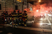 Minivan catches fire in Chinatown section of the Manhattan side of The Manhattan Bridge causes trafiic havoc in the late hours on March 24, 2009 in Manhattan, New York City