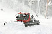 Snow making crew members push and shape a combination of natural and manmade snow machine in preparation for the upcoming ski season at Nubs Nob in Harbor Springs.  Both Nubs Nob and Boyna Highlands will be open for skiing this weekend.