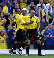 Fotball<br /> Foto: SBI/Digitalsport<br /> NORWAY ONLY<br /> <br /> Watford v Plymouth Argyle<br /> Coca-Cola Championship. 28/08/2004.<br /> <br /> Danny Webber ceelebrates his goal with James Chambers and Paul Devlin