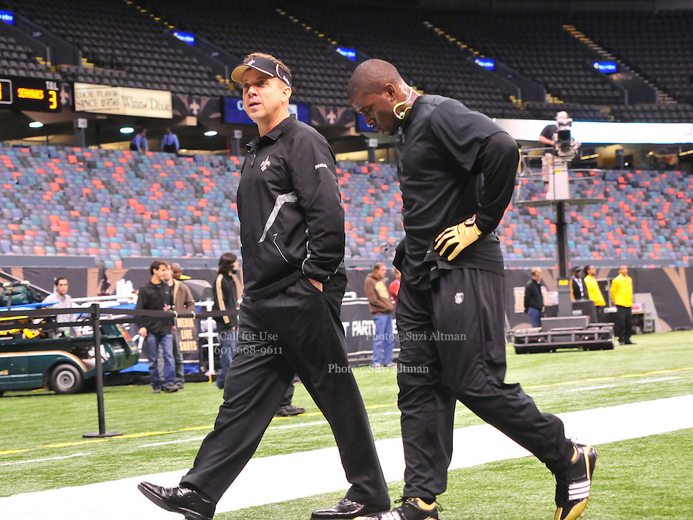 The New Orleans Saints Head Coach Sean Payton talks with RB Reggie Bush after Bush finished his pre game warm up. This game was to be BUsh's first game back since breaking his leg, Payton just let Bush know he would NOT be playing against the Seahawks,   play the Seattle Seahawks Sunday Nov. 21, 2010 in New Orleans at the Super Dome. It is RB Reggie Bush's first game to play since breaking his fibula and Reggie is also playing against his old USC college Coach. Photo©SuziAltman.