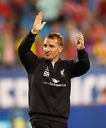 CHARLOTTE, USA - Saturday, August 2, 2014: Liverpool's manager Brendan Rodgers salutes the supporters after the 2-0 victory  over AC Milan during the International Champions Cup Group B match at the Bank of America Stadium on day thirteen of the club's USA Tour. (Pic by Mark Davison/Propaganda)