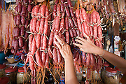 26 JUNE 2006 - SIEM REAP, CAMBODIA: A woman shops for sausage in the main market in Siem Reap, Cambodia, site of the world famous Angkor Wat. Photo by Jack Kurtz / ZUMA Press