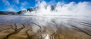 Geothermal steam rises from Grand Prismatic Spring. Yellowstone National Park, Wyoming, USA. This image was stitched from multiple overlapping photos.
