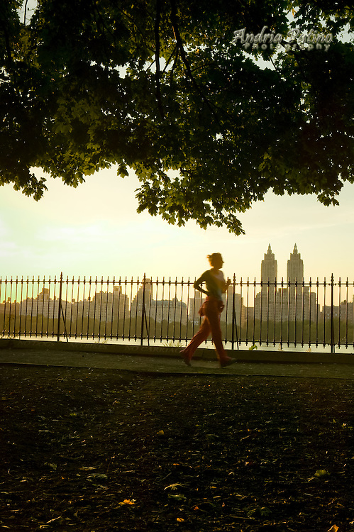Female jogger on the Jacqueline Kennedy Onassis Reservoir jogging track, New York