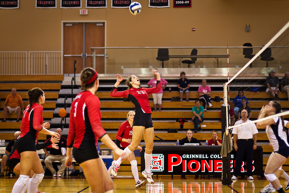 Claire Reeder '11, center, looks up in anticipation for a big spike during the Pioneers' win over Lawrence University in Darby Gymnasium on Saturday.